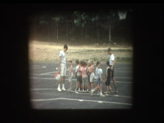 Camp counselor lines up kids in a straight line Stock Footage