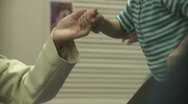 Adult and Child holding hands Stock Footage