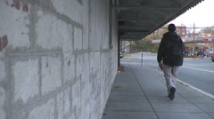 Student walking to school in Urban City Stock Footage