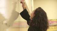 Stock Video Footage of Student's teacher writes on the board