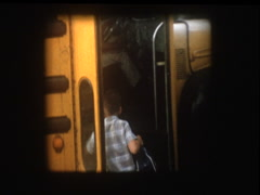 Little boy gets on antique school bus Stock Footage