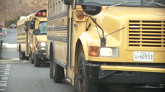 Stock Video Footage of School buses arrivals.