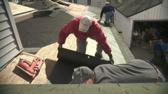 Construction work on a home roof. Stock Footage