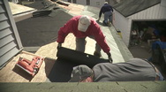 Stock Video Footage of Construction work on a home roof.