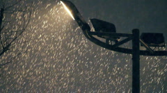 Plentiful snowfall in front of street light Stock Footage