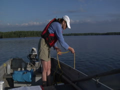 Woman Sampling Plankton in Lake Stock Footage