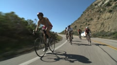 Cyclists Coasting in a Group - stock footage