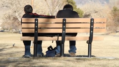 Brothers on park bench - stock footage