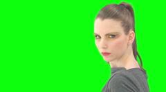 Greenkey woman turns around Stock Footage