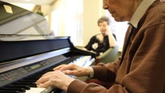 retirement home pianist Stock Footage