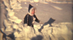 Little Girl Plays In The Snow (1940 Vintage 8mm) - stock footage