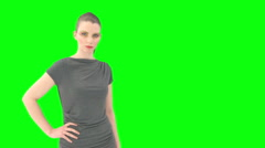 Woman looks demanding with greenkey Stock Footage