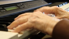 Elderly woman playing piano - stock footage