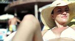 Young sexy woman in summer hat sunbathing Stock Footage
