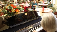 Pianist at retirement home - stock footage