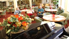 Piano at retirement home Stock Footage