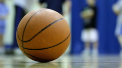 Basketball on sideline of court - stock footage