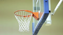 Practicing shoot at basketball hoop indoors Stock Footage