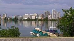 Puerto Rico - Paddle Boats-Condado Lagoon-Buildings-Water Reflections 2 Stock Footage