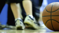 Low view of Basketball sitting on Court Stock Footage