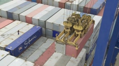 Pair of containers being unloaded from ship Stock Footage