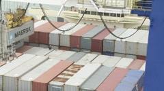 Container being swung across ship Stock Footage