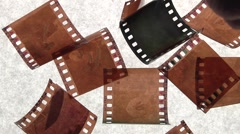 Negative film pieces fall Stock Footage