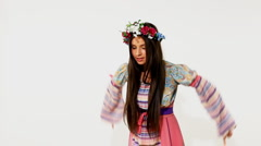 Beauty russian girl with garland - ethnic dance Stock Footage