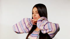 Young girl take care of long hair - russian ethnic costume Stock Footage