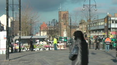 Busy paved High Street with market stall selling flowers Stock Footage