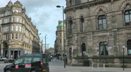 Stock Video Footage of Taxi pulls away from the taxi rank another moves forward