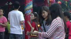 Lighting Incense Outside The Temple Stock Footage
