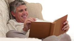 Retired man looking at an album Stock Footage