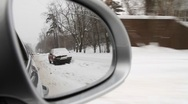Tracking shot of Moscow road covered with snow seen from side mirror of car Stock Footage