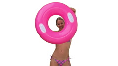 An attractive lady in swimsuit playing with a rubber ring Stock Footage