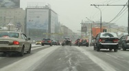Driving through downtown of city covered with white snow - HD 1920 X 1080 Stock Footage