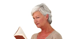 Senior woman reading a book Stock Footage