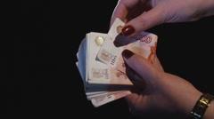 Hands count money Stock Footage