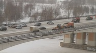Traffic on bridge covered with white snow on snowy day - HD 1920 X 1080 Stock Footage