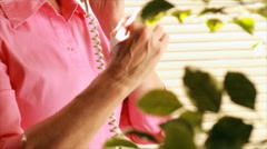 Woman with arthritic hand phone call Stock Footage