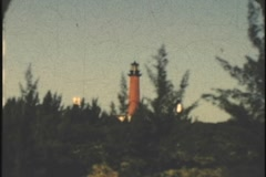 8mm 1950's Jupiter Florida ligthouse viewed from intercoastal waterway 8mm Stock Footage