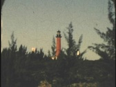 Stock Video Footage of 8mm 1950's Jupiter Florida ligthouse viewed from intercoastal waterway 8mm
