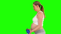 Pregnant lady with dumbbells Stock Footage