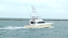 Boats yellow sporfishing boat idling away from camera h264 Stock Footage