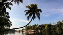 Traditional Houseboat traveling along the backwaters, Kerala, India Stock Footage