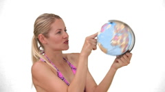 Women in swimsuit chosing a destination of travel Stock Footage
