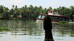 Pleasure boat on the Kerala backwaters, nr Alleppey, Kerala, India - stock footage
