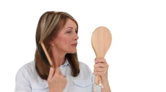 Mature woman tidying her hair Stock Footage