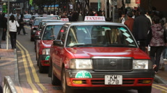 Taxis line on hong kong city street Stock Footage