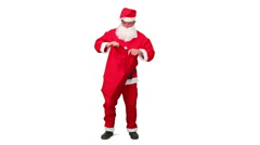 Santa Claus taking out a gift from his bag Stock Footage